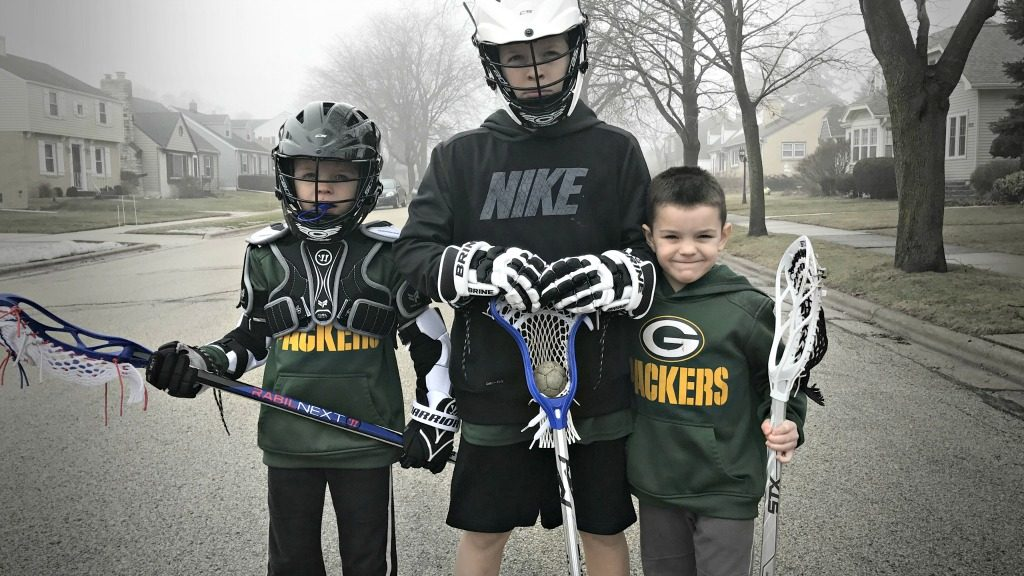 Boys in lacrosse equipment