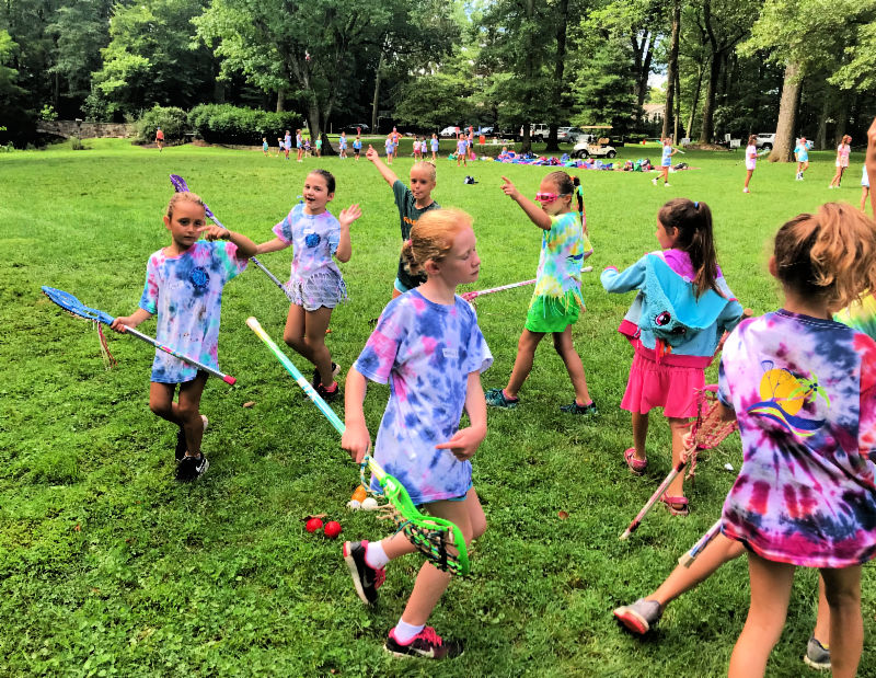Girls having fun doing a lacrosse drill at Swax Lax Lacrosse summer camp