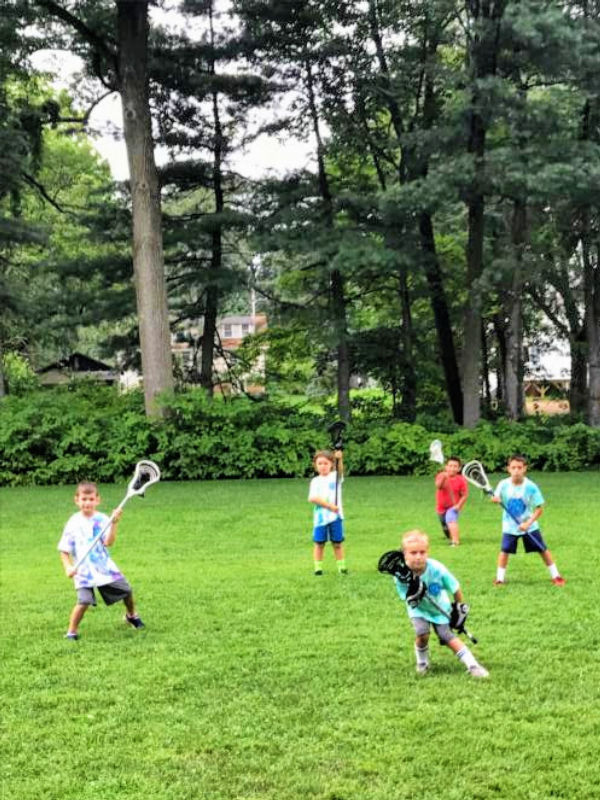 Boys having run learning lacrosse at Swax Lax Lacrosse summer camp