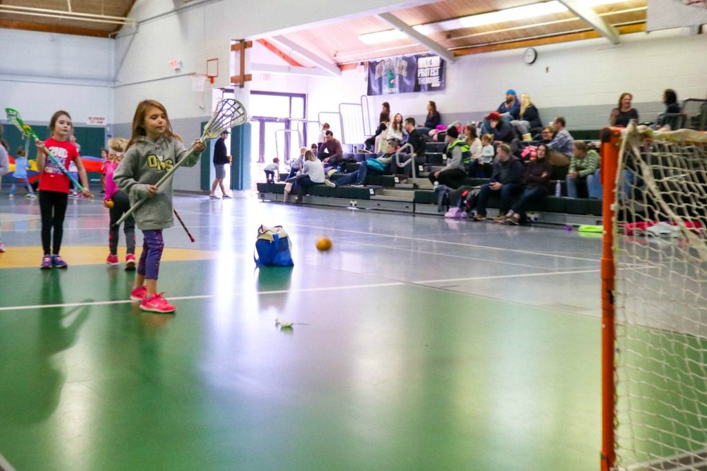 Girls playing lacrosse at Swax Lax Lacrosse Indoor Lacrosse Clinic
