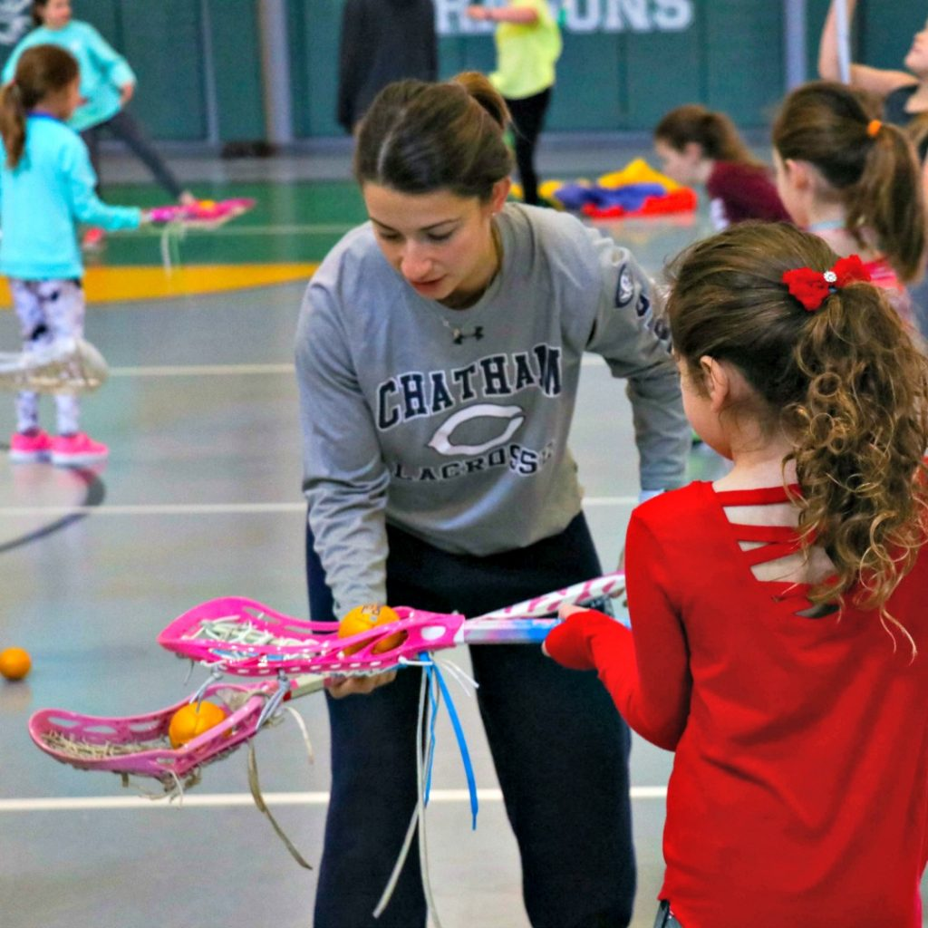 Girls Indoor Winter Lacrosse Clinic working on stick tricks