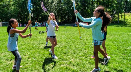 It's never too late to learn lacrosse - older girls starting out at lacrosse camp