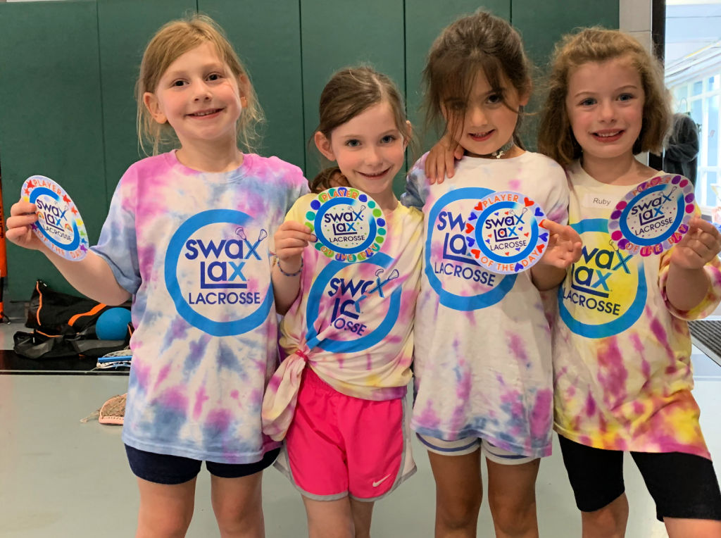 Girls wearing their tie-dyed Swax Lax Lacrosse t-shirts